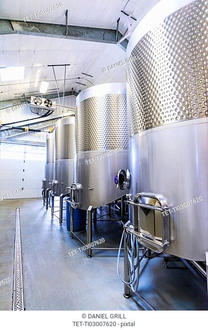 Stainless steel tanks in winery cellar