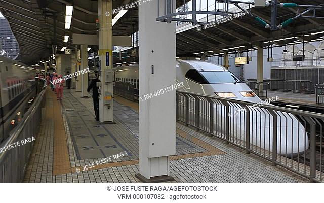 Japan-Tokyo City-The Bullet train ariving atTokyo Station-Marunouchi skyline
