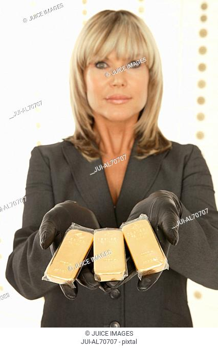 Woman displaying gold bullion
