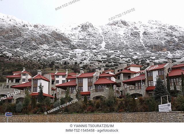 View of Arachova town and snowy mountains in the background. Kellaria, Parnassos, Arachova, Viotia, Central Greece, Europe