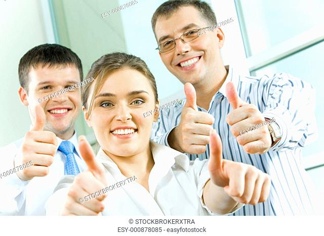 Image of business people showing sign of okay