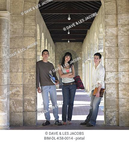 Three university students standing on a concourse, Perth, Australia
