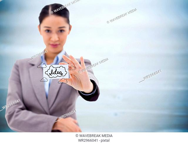 Business woman holding out card showing idea doodles against blurry blue wood panel