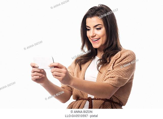 Young attractive female using mobile phone. Debica, Poland