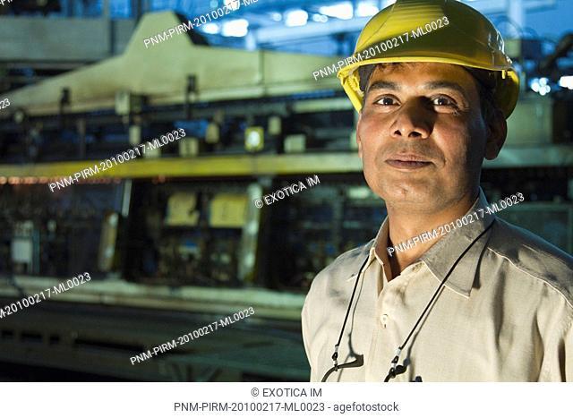 Portrait of a male engineer in a factory, Surya Roshni Limited, Gwalior, Madhya Pradesh, India