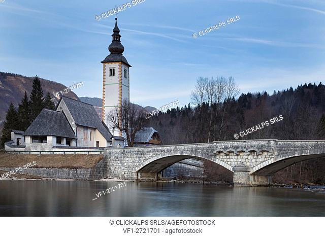 Europe, Slovenia, Upper Carniola. Church of Sv. John the Baptist and the stone bridge by the Bohinj lake