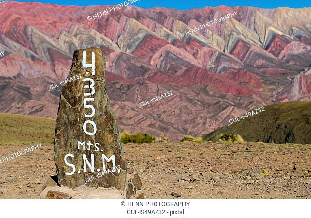 Altitude marker at the colourful mountains of Humahuaca, 4,300m altitude, Jujuy, Argentina, South America