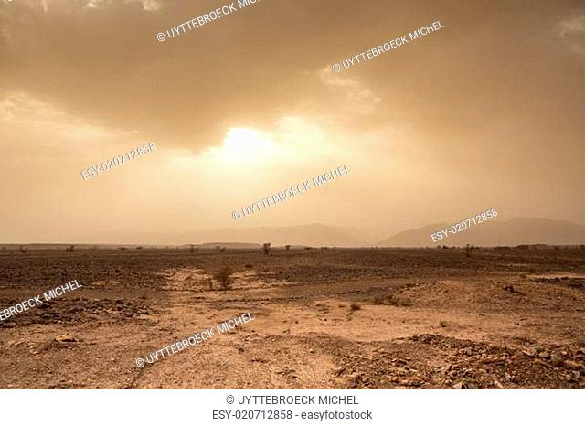 Threatening sky and wind in the desert of Sahara in Morocco