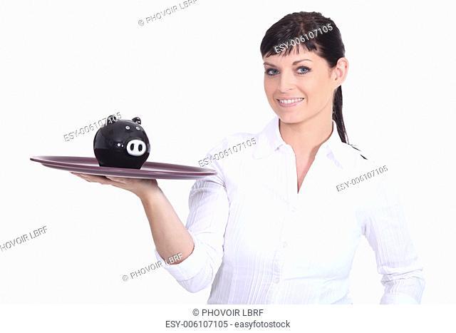 Waitress holding piggy bank