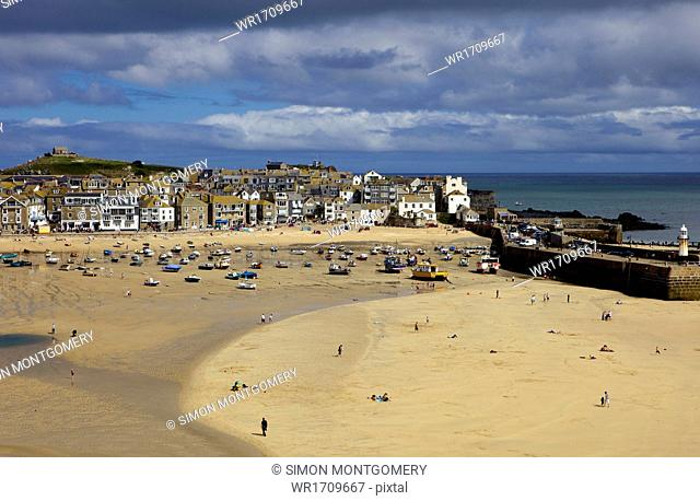 Looking across the harbour at St. Ives at low tide towards St. Ives Head, Cornwall, England, United Kingdom, Europe
