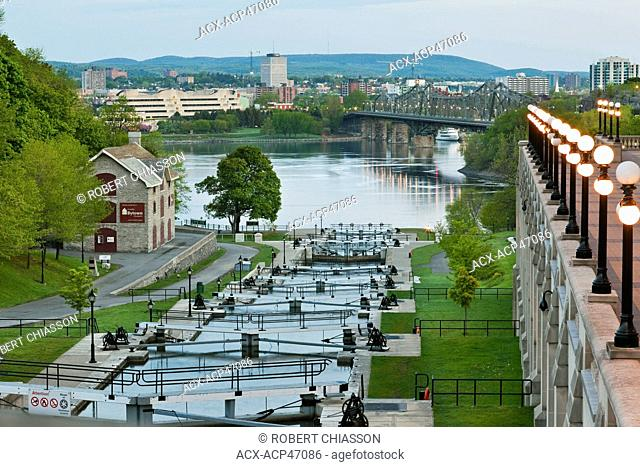 Rideau Canal Locks which empty into the Ottawa River in downtown Ottawa, Ontario, Canada. In the background is the city of Gatineau, formerly named Hull
