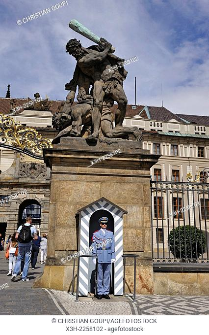 guard under one of the statues, depicting Giants fighting, at the entrance of Castle of Prague, Czech Republic, Europe