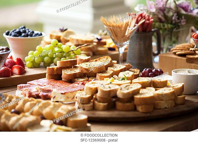 Various party snacks on a wooden table