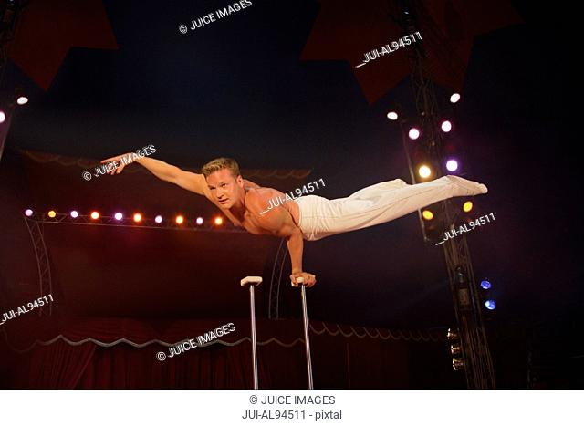 Male acrobat balancing at circus