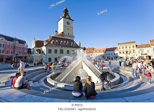 Tourists near fountain at town square, Kronstadt, Brasov, Transylvania, Romania