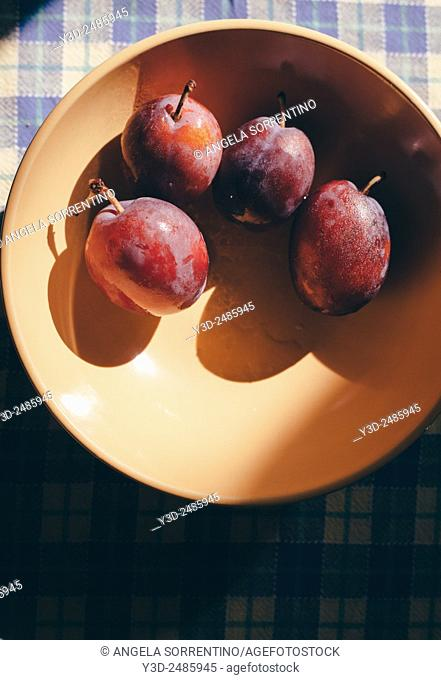 Plums in a bowl