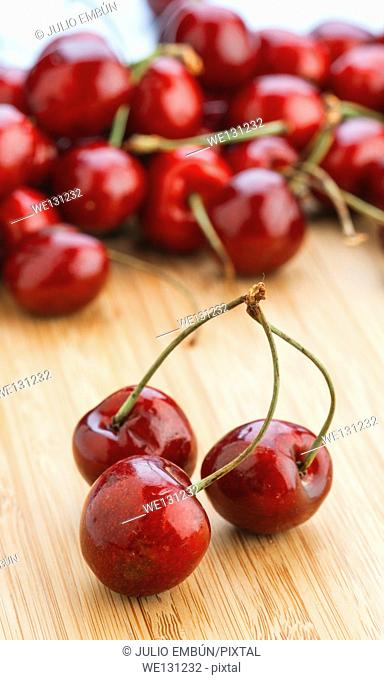 Group of cherries on wooden table