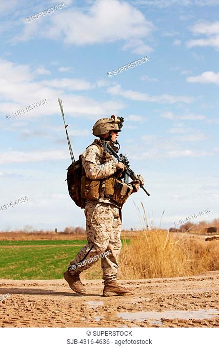 United States Marine on a combat patrol near the city of Marjah, in the Helmand Province of Afghanistan