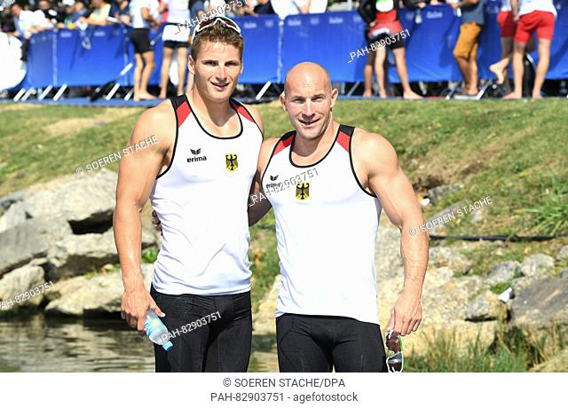 Ronald Rauhe (R) and Tom Liebscher of Germany pose after the Men's Kayak Double 200m final of the Canoe Sprint events of the Rio 2016 Olympic Games at Lagoa...