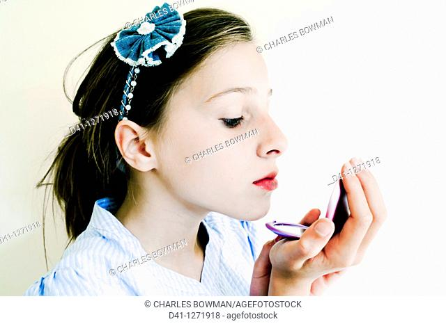 Child applying makeup
