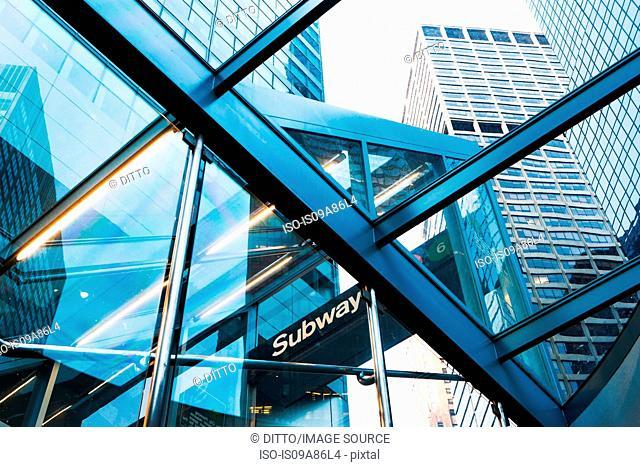 Skyscrapers through subway entrance, New York City, USA