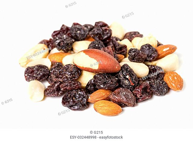 Dried fruits and nuts on a white background. Student meal