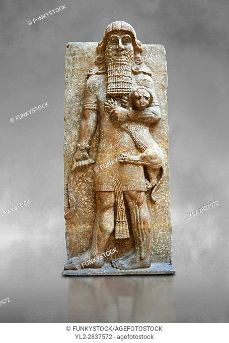 Stone statue of a Hero holding a lion. From facade M of the palace courtyard , Inv AO 19861 from Dur Sharrukin the palace of Assyrian king Sargon II at...