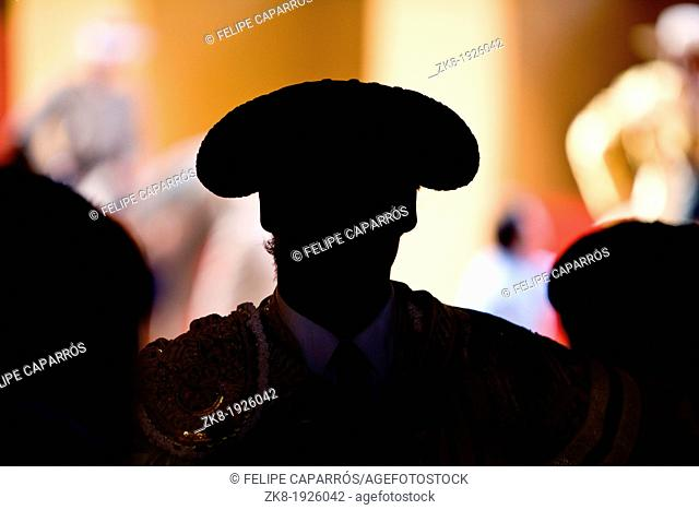 Silhouette of a bullfighter's head wearing the traditional hat or 'montera', spain