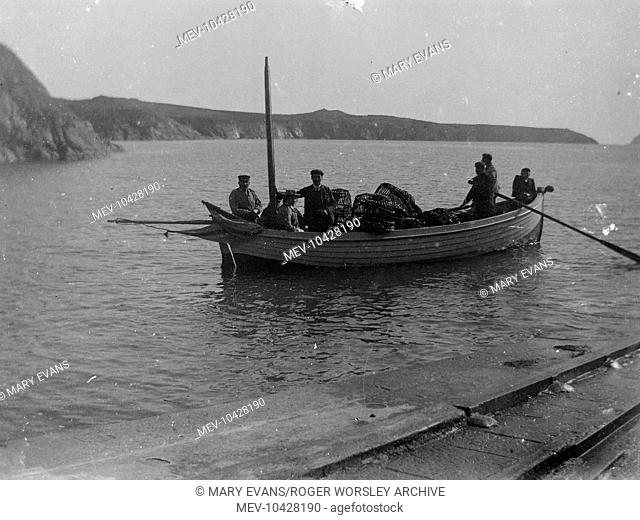 People in the St Justinian's lifeboat, near the lifeboat station, on the Pembrokeshire coast, Dyfed, South Wales