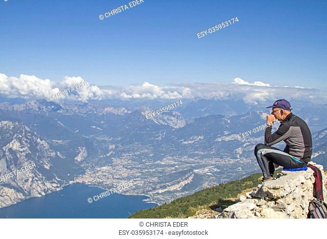 mountain bikers enjoy after their driveway to the altissimo the magnificent view of lake garda