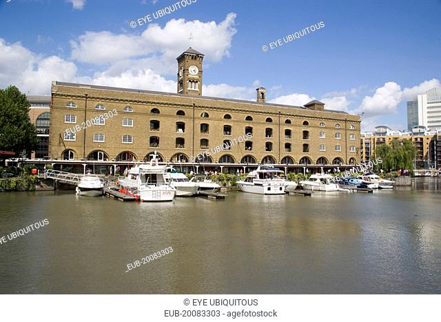 St Catherine's Dock with yachts moored next to the former warehouses which are now luxury apartments
