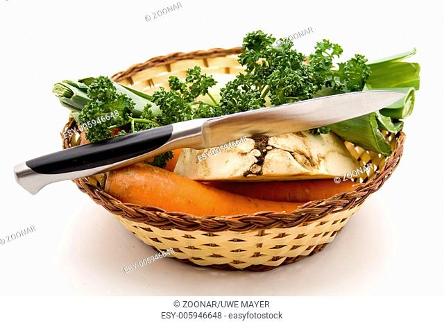 Soup vegetables with knife