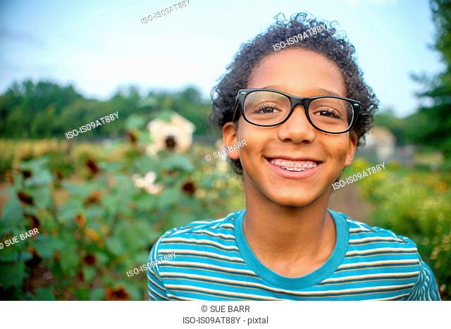 Portrait of boy in farm field