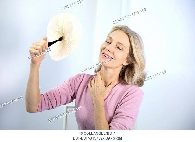 A menopausal woman having a hot flush