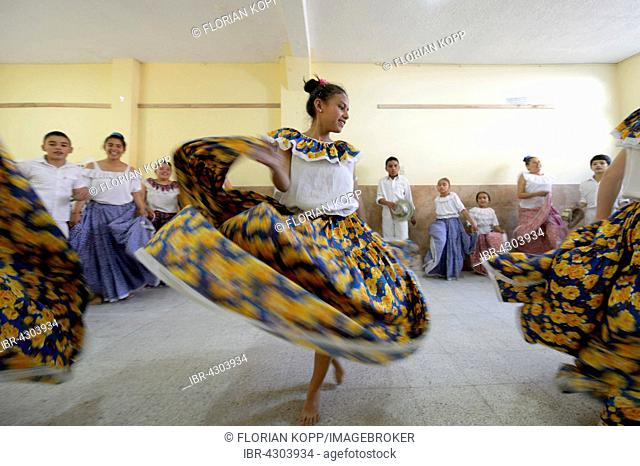 Girl dancing, flying skirt, dance group, folk dance, traditional dance, Barrio San Martín, Bogotá, Colombia