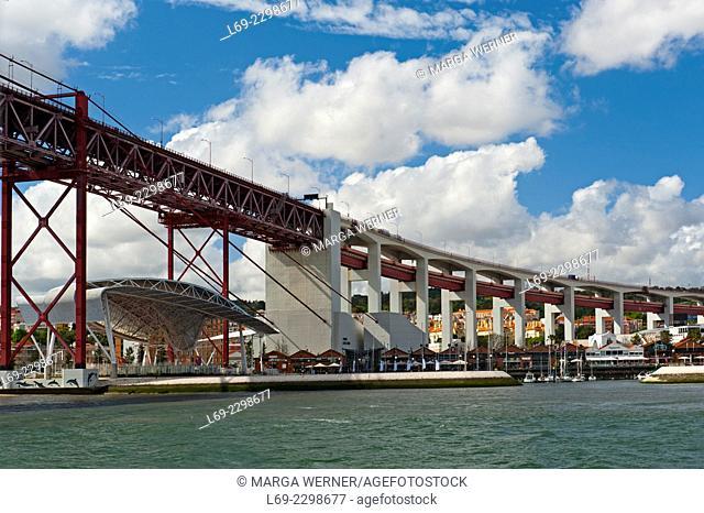 "Ponte 25 de Abril """"25th of April Bridge, before Salazar bridge, crossing river Tejo, and Doca de San Amaro, marina at the riverside, Lisbon, Portugal, Europe"