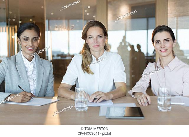 Portrait smiling, confident businesswomen working in conference room meeting