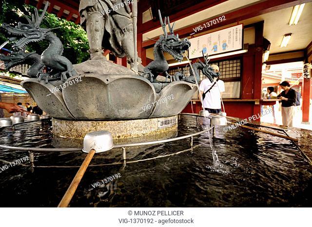 JAPAN, TOKYO, 06.07.2008, Purification water. Senso-ji (aka Asakusa Temple), Buddhist Temple dedicated to the Bodhisattva Kannon and the oldest temple in Tokyo