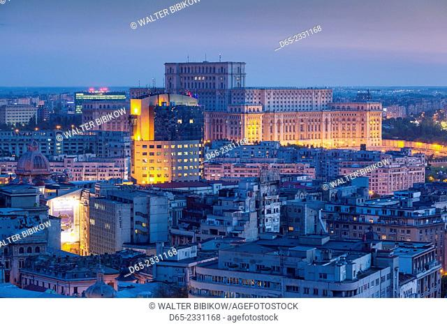Romania, Bucharest, Palace of Parliament, world's second-largest building, elevated view, dusk