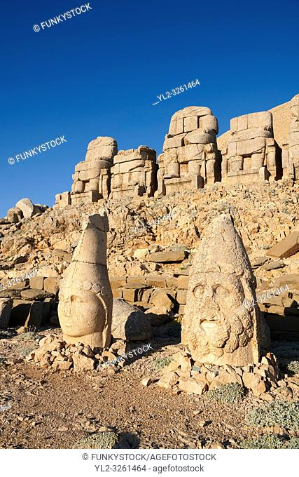 Statue heads, from right, Herekles & Apollo with headless seated statues in front of the stone pyramid 62 BC Royal Tomb of King Antiochus I Theos of Commagene