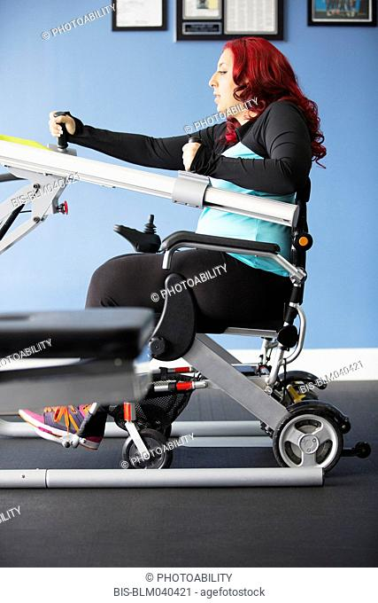 Disabled woman doing physical therapy