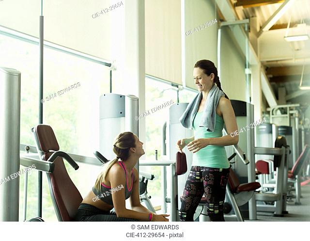 Women talking and resting at gym