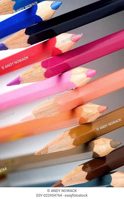 cross-stacked pencils slanting