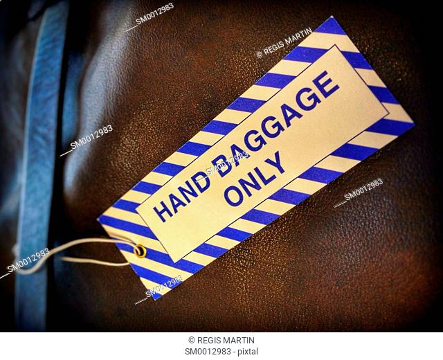 Hand Baggage tag on a leather luggage