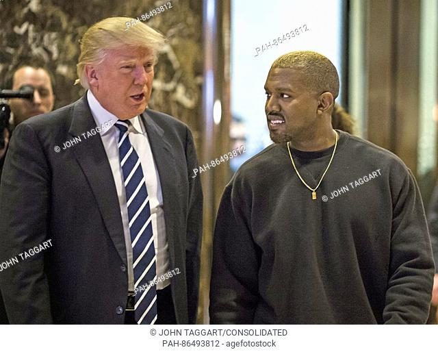 United States President-elect Donald J. Trump and Musician Kanye West pose for photographers in the lobby of Trump Tower in Manhattan, New York, U.S