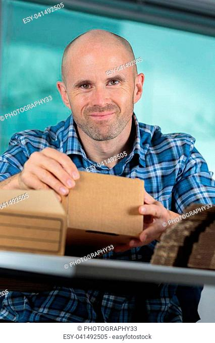 delivery man holding carton box