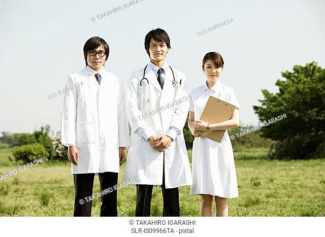 Male doctors and female nurse, portrait