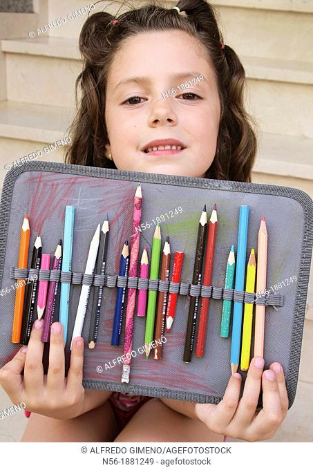 Girl with color crayons