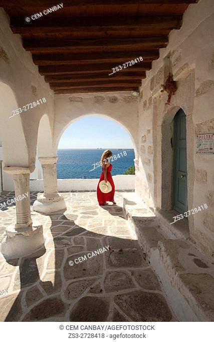 Woman near the columns of the main church in Parikia, Paros, Cyclades Islands, Greek Islands, Greece, Europe