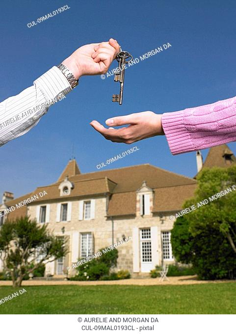 Woman receiving keys to country home